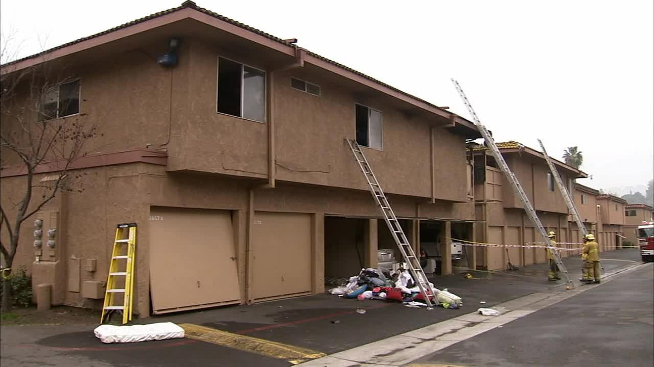 Firefighters on scene of an apartment fire in San Juan Capistrano on Tuesday, Jan. 20, 2015.