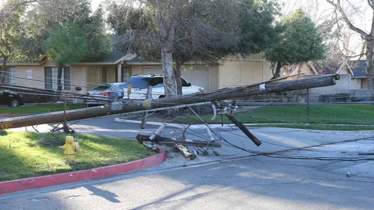 Strong winds toppled power lines at Cottonwood and Seville avenues in Fontana on Saturday, Jan. 24, 2015.
