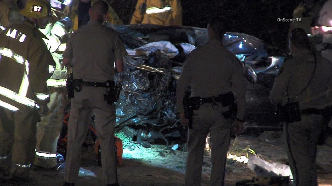 Los Angeles firefighters and California Highway Patrol officers respond to a fatal accident that killed two people off of the 118 Freeway in Chatsworth on Sunday, Jan. 25, 2015.