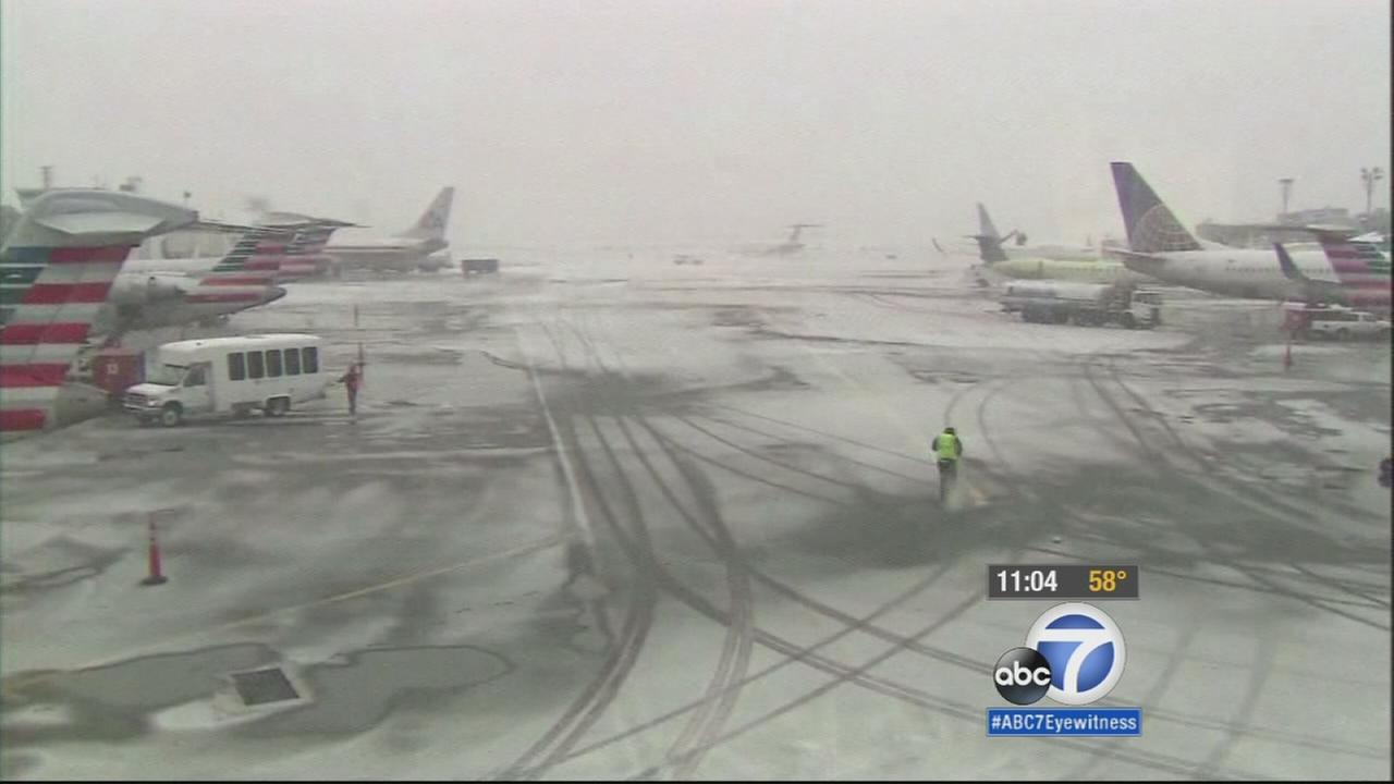 More than 80 flights out of Los Angeles International Airport were canceled Monday in preparation of a history-making storm expected to drop 1 to 3 feet of snow on the East Coast.