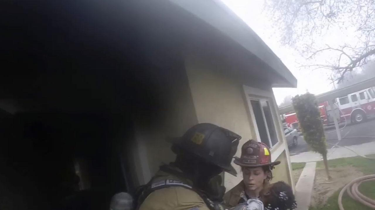 Four Fresno firefighters are being hailed heroes for saving three young children. Newly released dramatic video takes you inside the rescue.