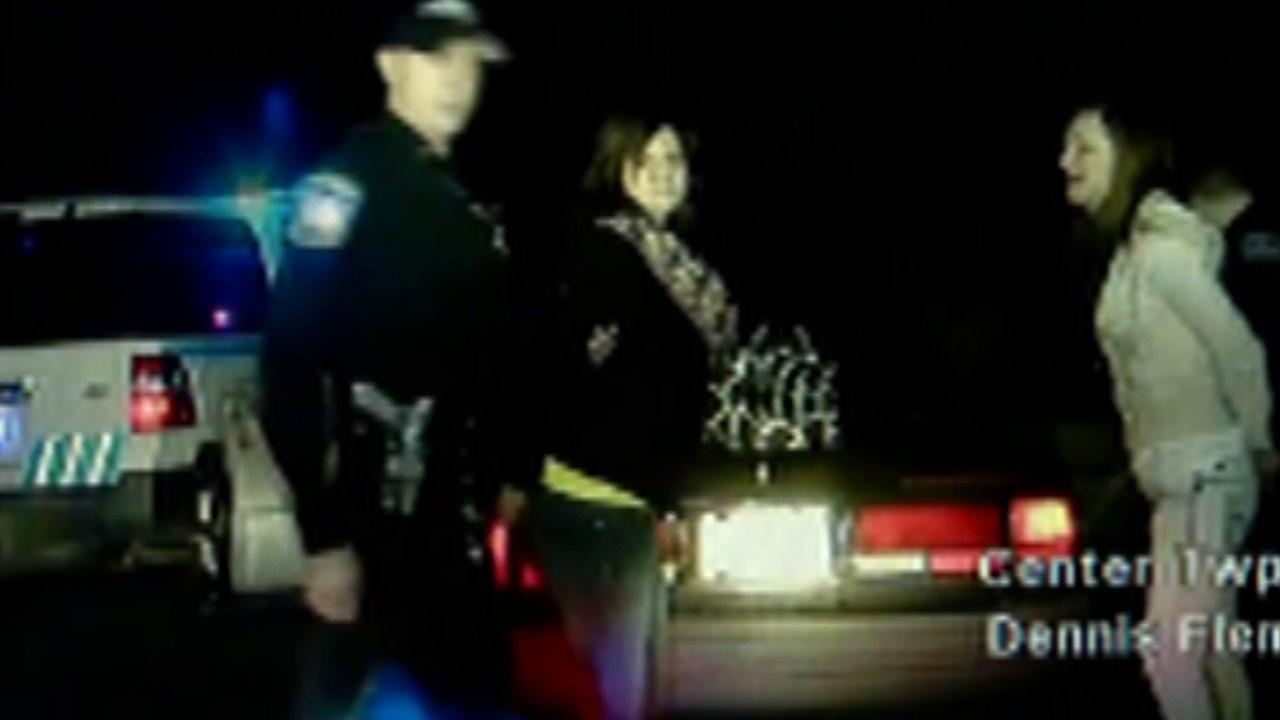 A woman has been ordered to stand trial on charges she stole a police cruiser and led officers on an 80 mph chase - all while her hands were cuffed behind her.