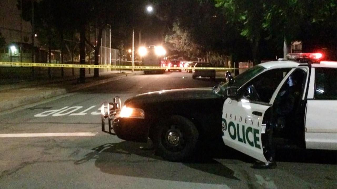 Police investigate a deadly shooting at Villa Parke in Pasadena on Wednesday, Jan. 28, 2015.
