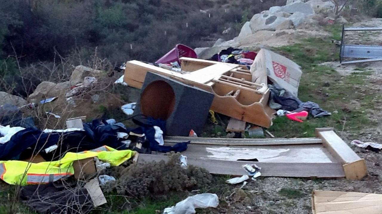 Trash is strewn across the ground at Box Springs Mountain Park in Moreno Valley.