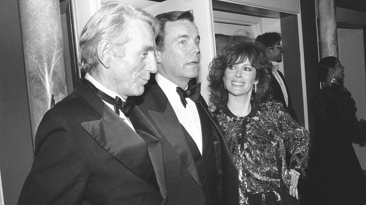 Rod Mckuen, left, attends a party with Jill St. John with Robert Wagner after the Night of 100 stars II on Feb. 18, 1985.