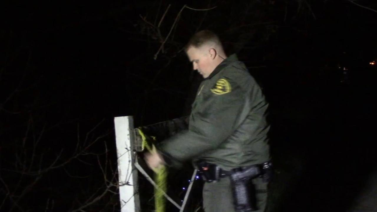 A Los Angeles County sheriffs deputy blocks off an area where a man was found stabbed in a possible roommate altercation in Green Valley on Saturday, Jan. 31, 2015.