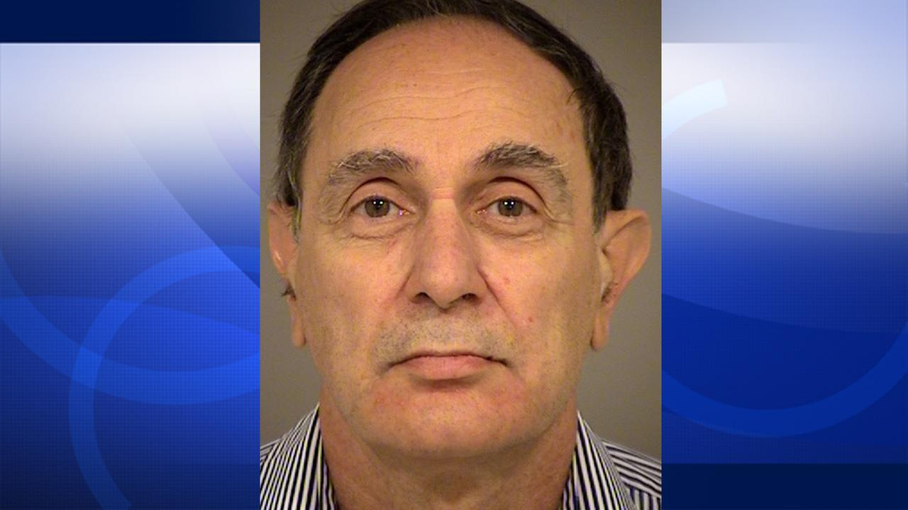 Leopold Weinstein, 63, is seen in his booking photo.