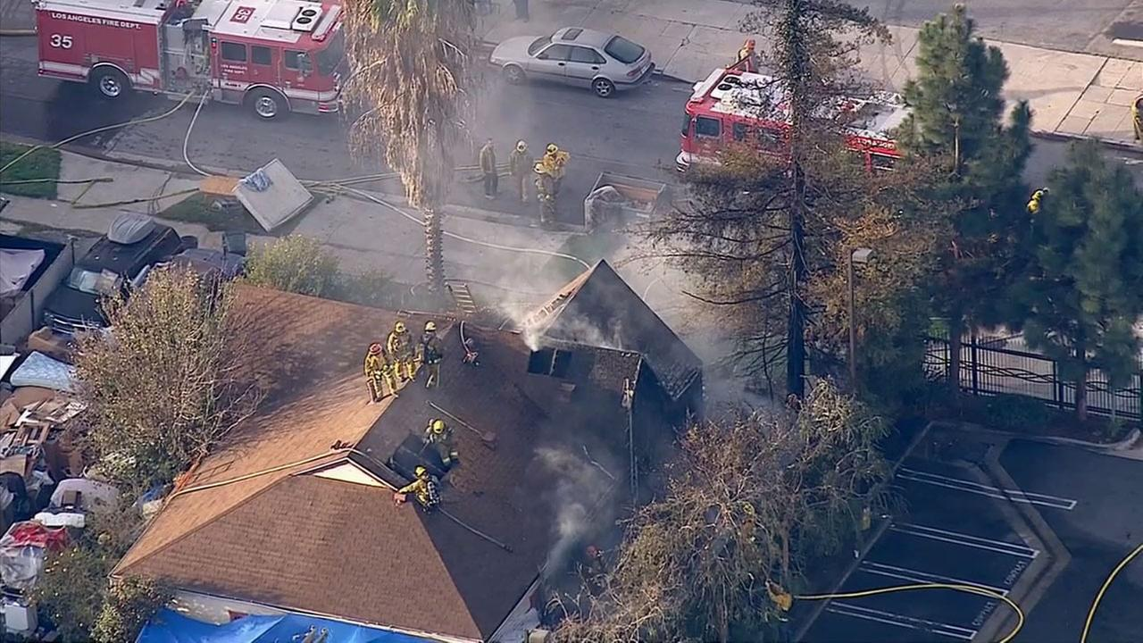 Firefighters respond to a house fire in Los Angeles Atwater Village neighborhood on Monday, Feb. 2, 2015.