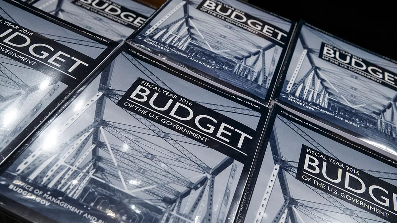 President Barack Obamas new $4 trillion budget plan is distributed by a Senate Budget Committee staffer as it arrives on Capitol Hill in Washington, early Monday, Feb. 2, 2015.