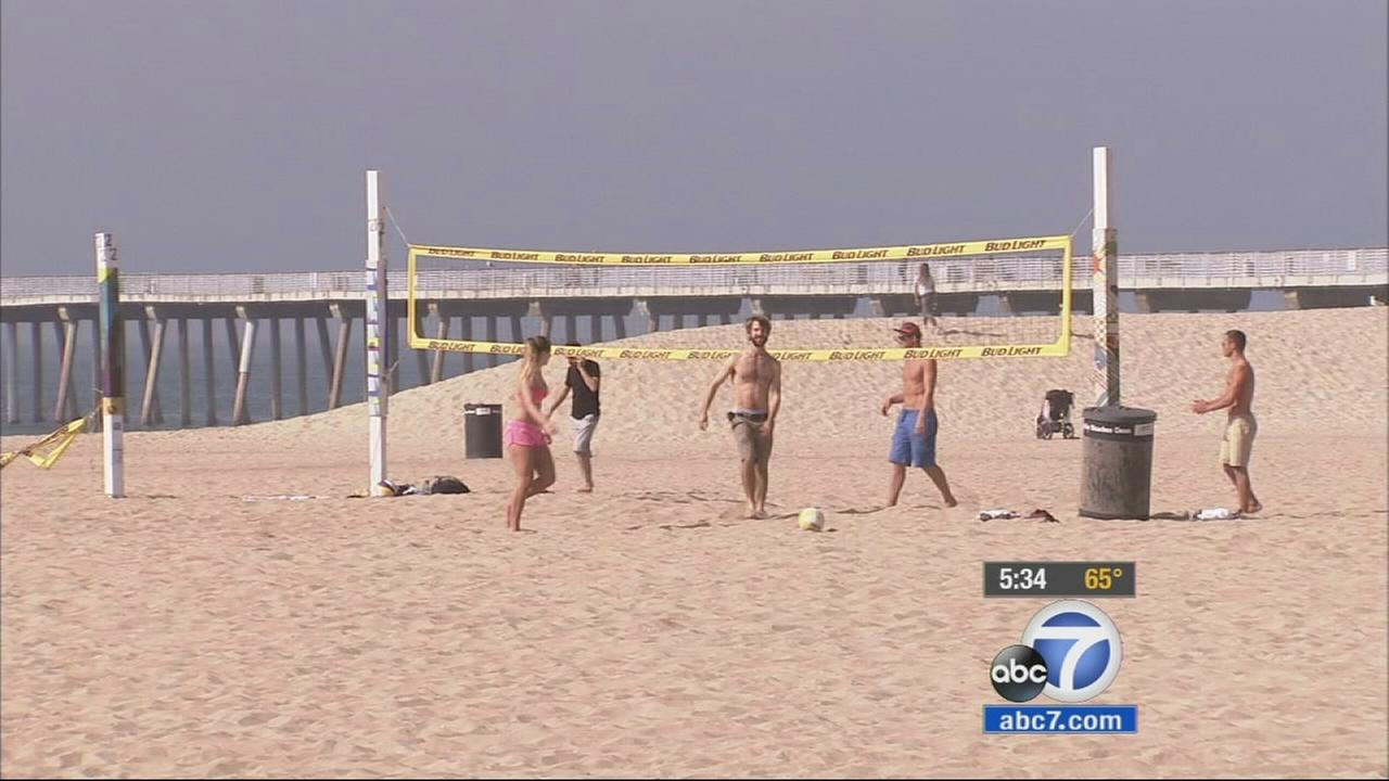 People are shown playing volleyball at Hermosa Beach in this February 2015 photo.