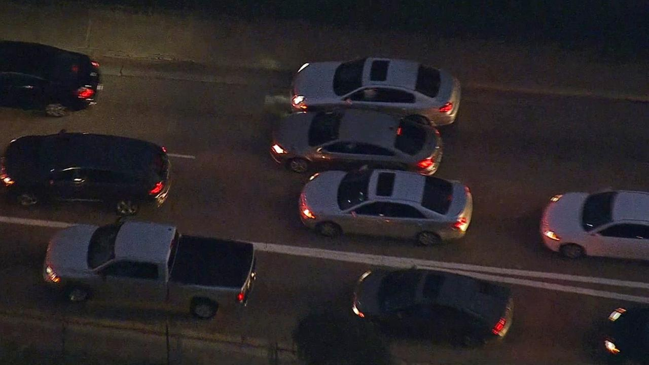 A car chase suspect is stuck in between cars on the 60 Freeway near Findlay Avenue on Monday, Feb. 9, 2015.