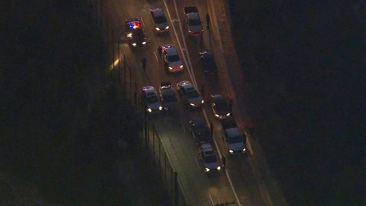 The eastbound 60 Freeway was shut down by LAPD after a stolen vehicle suspect was shot on Monday, Feb. 9, 2015.