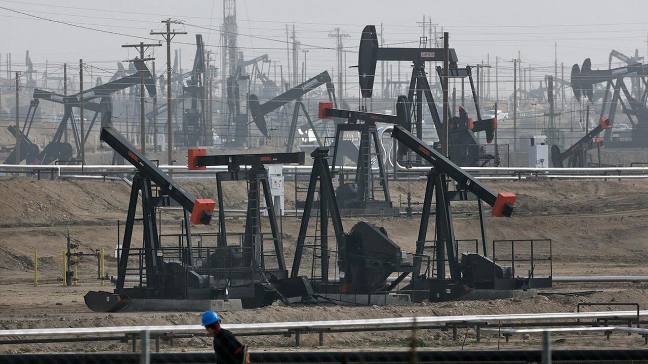 This Jan. 16, 2015, file photo shows pumpjacks operating at the Kern River Oil Field in Bakersfield, Calif.