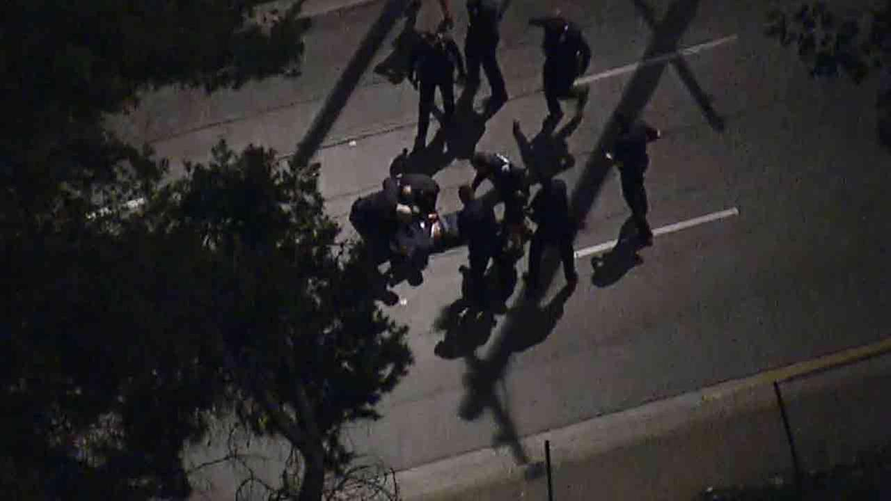 An armed stolen vehicle suspect was shot by police and transported to a local hospital after leading Los Angeles police on a pursuit Monday, Feb. 9, 2015.
