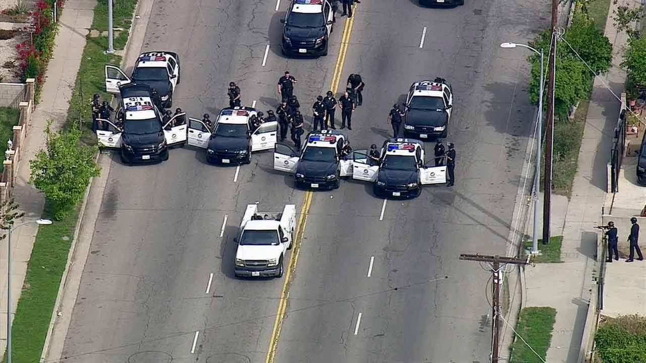 Law enforcement officers surround a chase suspect on Wednesday, Feb. 11, 2015.