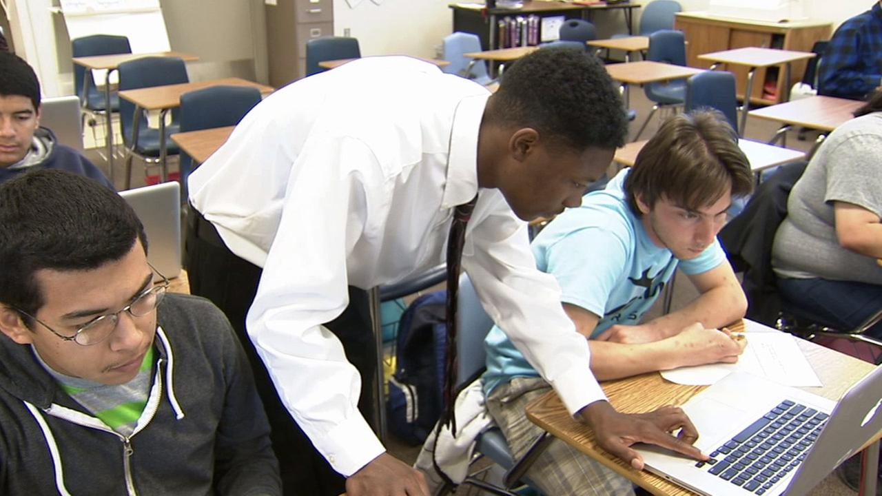 Cool Kid TrayVeon Dozier, shown above, helps out special education students learn computer skills at Pacific High School in San Bernardino.