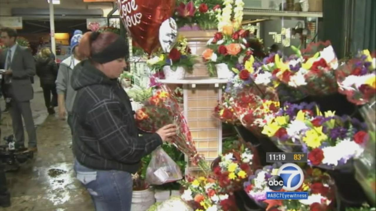 Valentines Day shoppers packed the downtown Los Angeles Flower District Friday to buy some beautiful blooms for their loved ones.