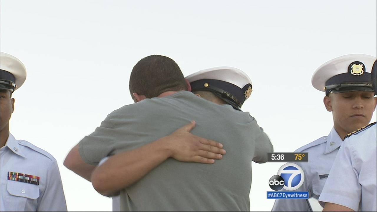 Joe Blushtein hugs a Coast Guard personnel who helped rescue him from the ocean in September 2014.