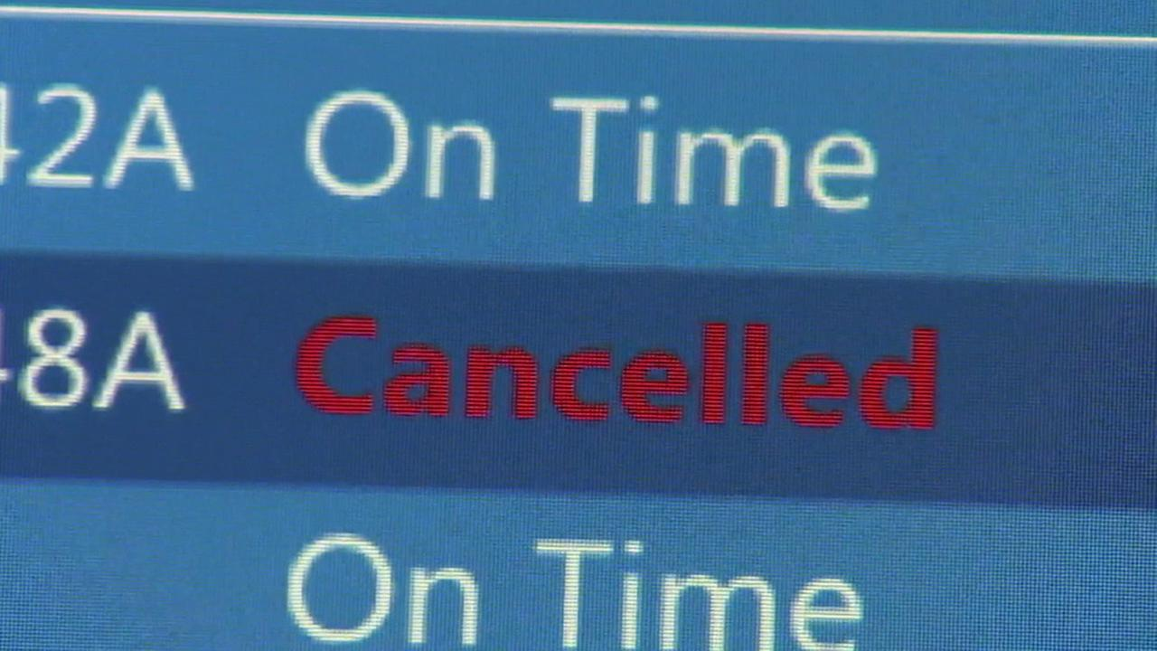 A departures sign at Los Angeles International Airport shows that a flight to Boston has been canceled on Sunday, Feb. 15, 2015.