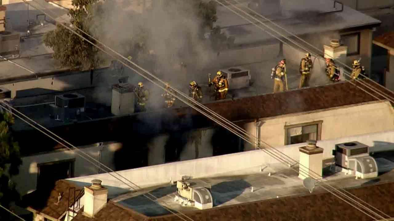 Los Angeles County firefighters respond to the scene of a fire following an explosion at a multi-unit apartment building in the 4200 block of Walnut Grove Avenue in Rosemead.