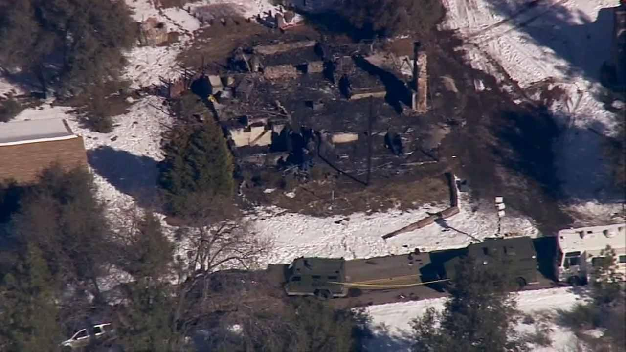 The charred remains of the Angelus Oaks cabin where former LAPD officer Christopher Dorner was holed up during a gun battle with police in February 2013 is shown in this photo.
