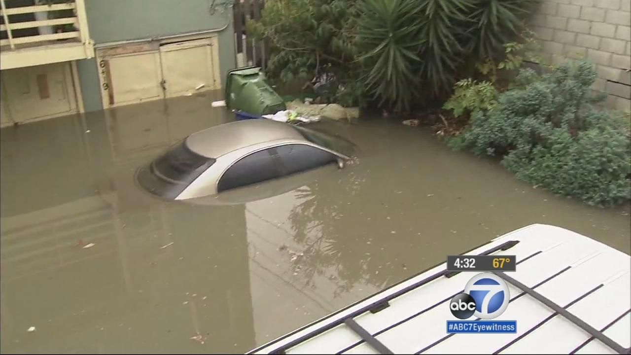 A car was submerged in water after a water main broke in Hollywood on Wednesday, Feb. 18, 2015.