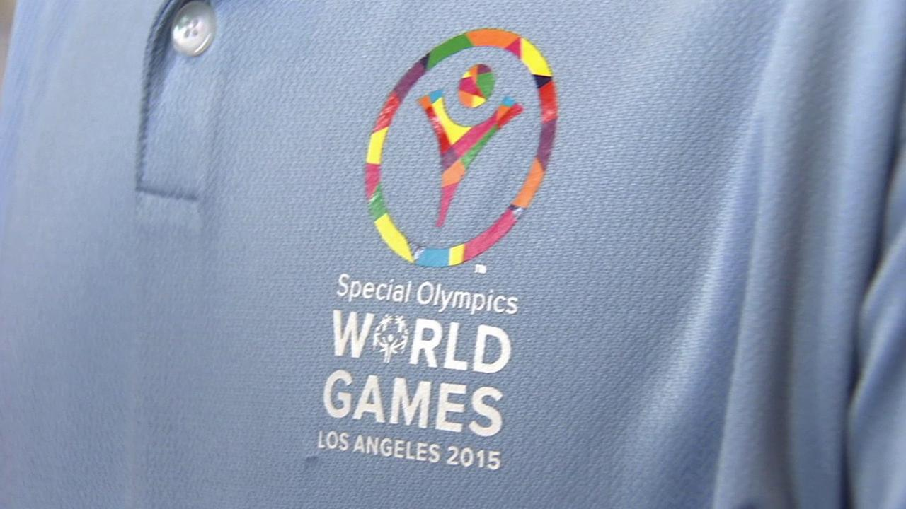 The Special Olympics World Games Los Angeles 2015 logo is shown on a polo shirt.