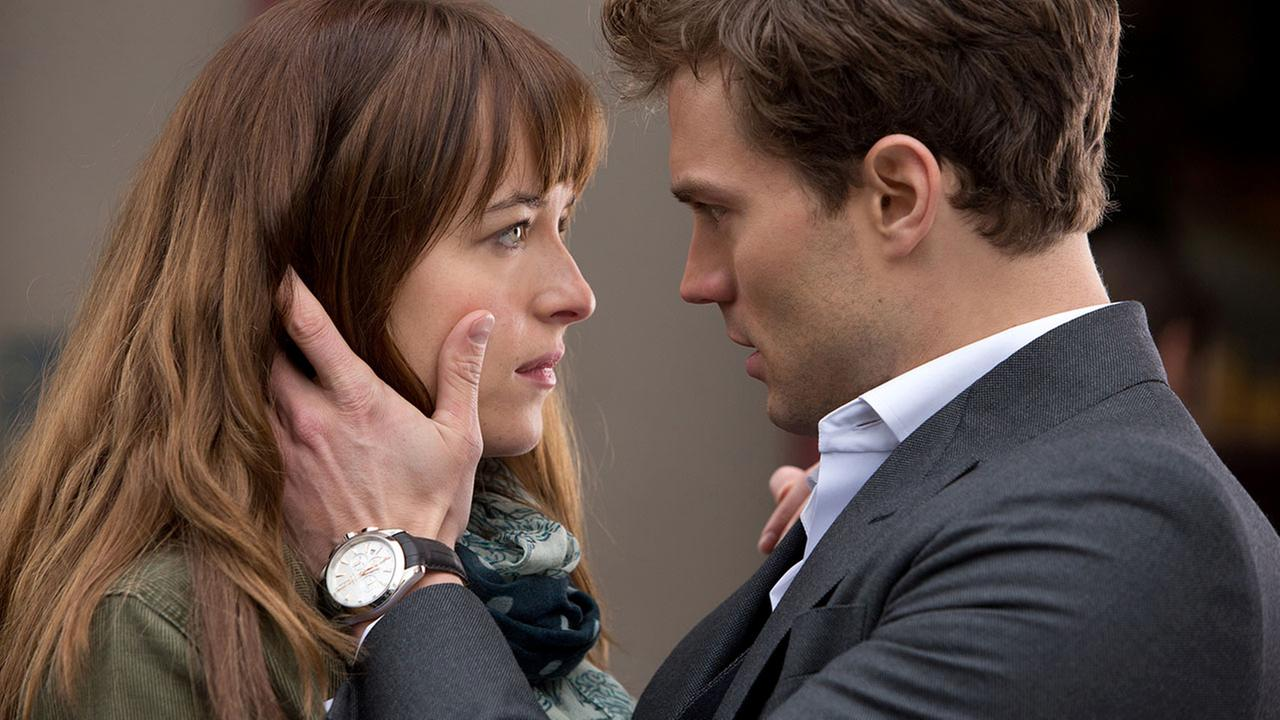 In this image released by Universal Pictures and Focus Features, Dakota Johnson, left, and Jamie Dornan appear in a scene from Fifty Shades of Grey.
