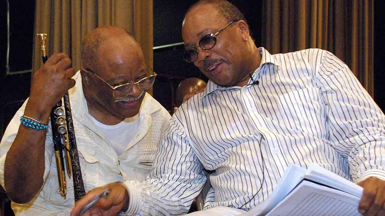 This June 13, 2001, file photo shows Quincy Jones, right, talking with jazz musician Clark Terry at a rehearsal of Sonic Convergence, in New York.