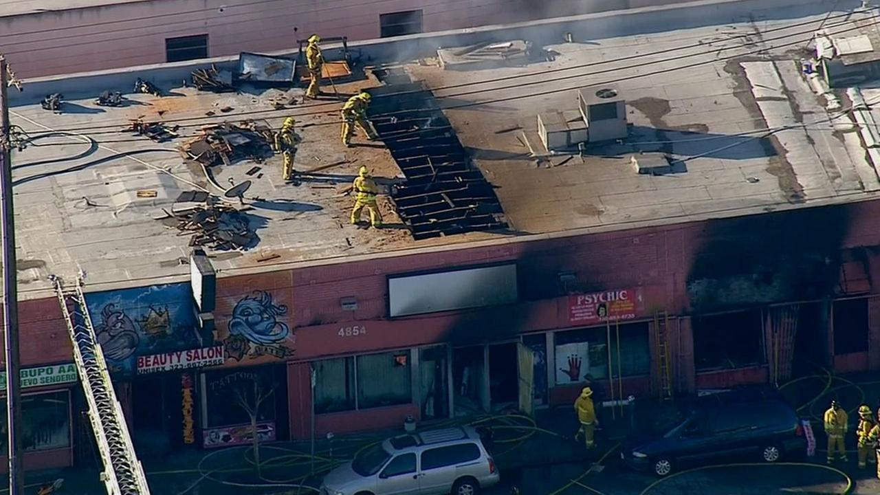 Firefighters put out the flames at an East Hollywood strip mall on Wednesday, Feb. 25, 2015.