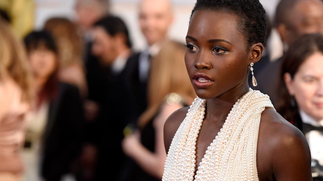 Lupita Nyongo arrives at the Oscars on Sunday, Feb. 22, 2015, at the Dolby Theatre in Los Angeles.