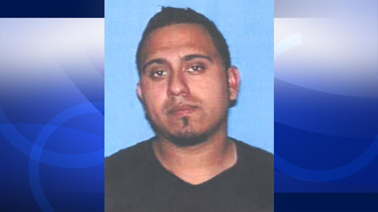 Eric Siguenza is shown in his drivers license photo.