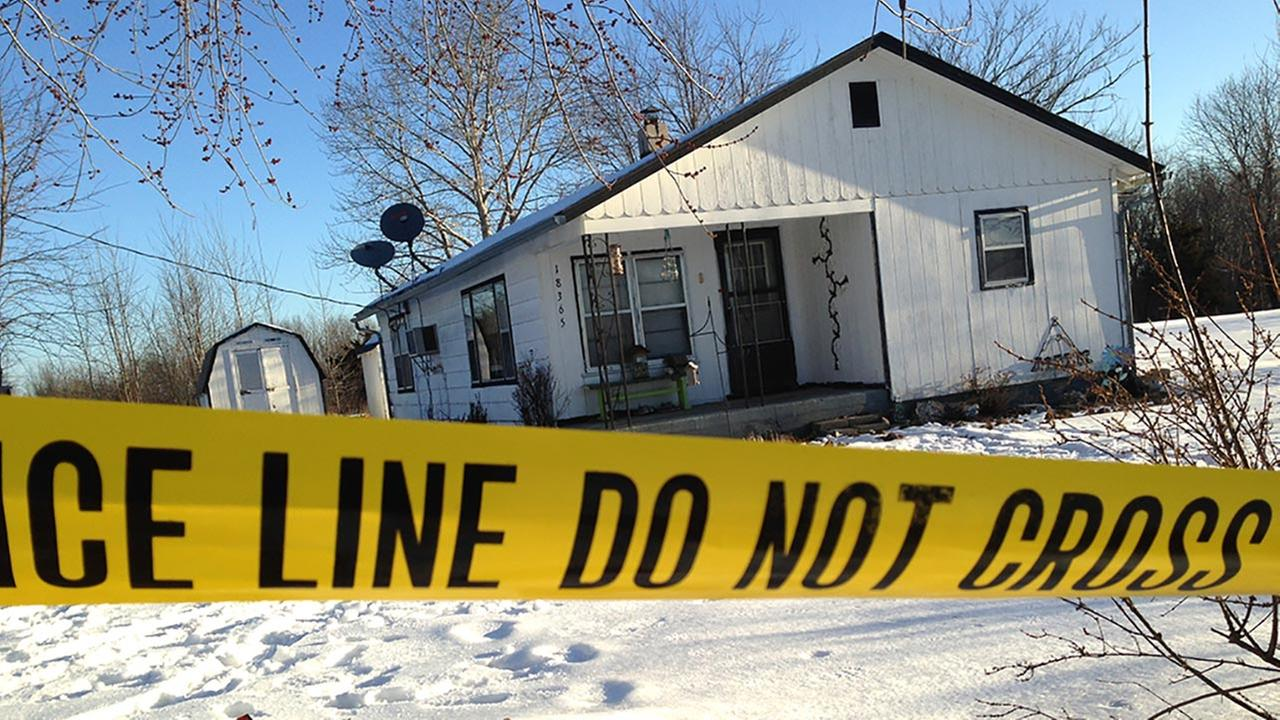 Police tape surrounds one of the crime scenes in Tyrone, Mo., Friday, Feb. 27, 2015.