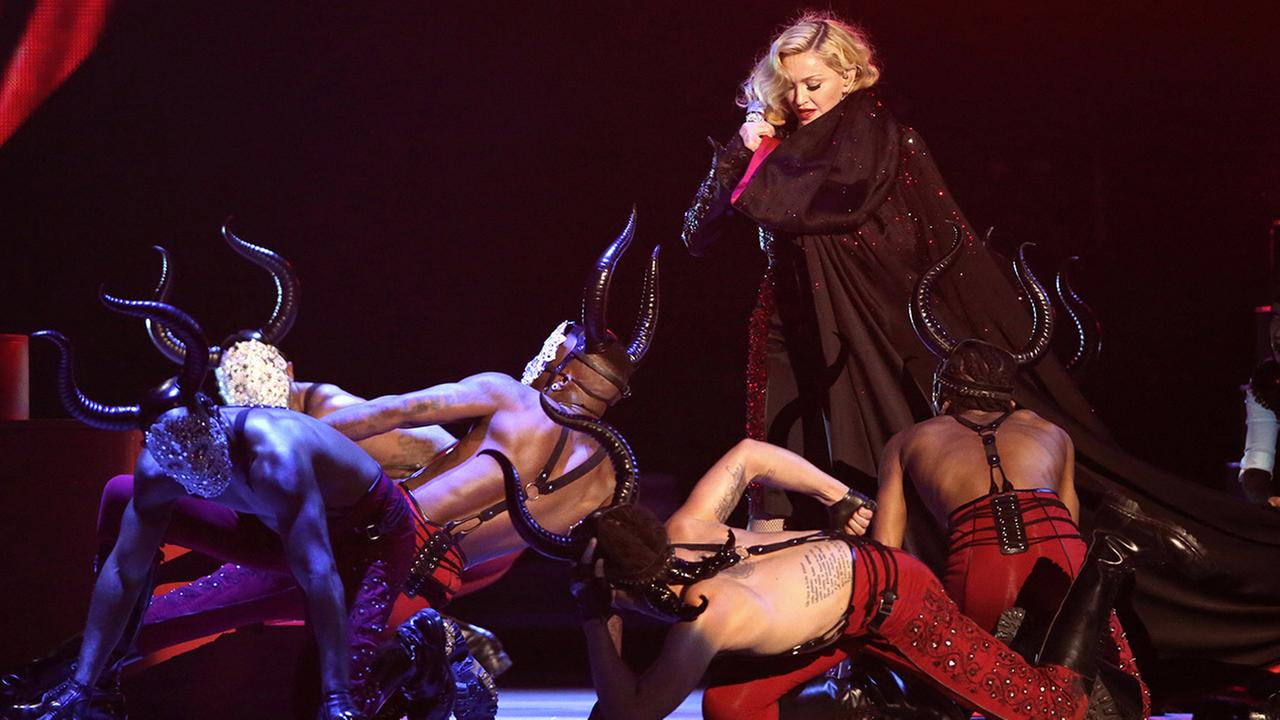 Madonna returns to her feet after an apparent unscripted fall onstage at the Brit Awards 2015 at the 02 Arena in London, Wednesday, Feb. 25, 2015.