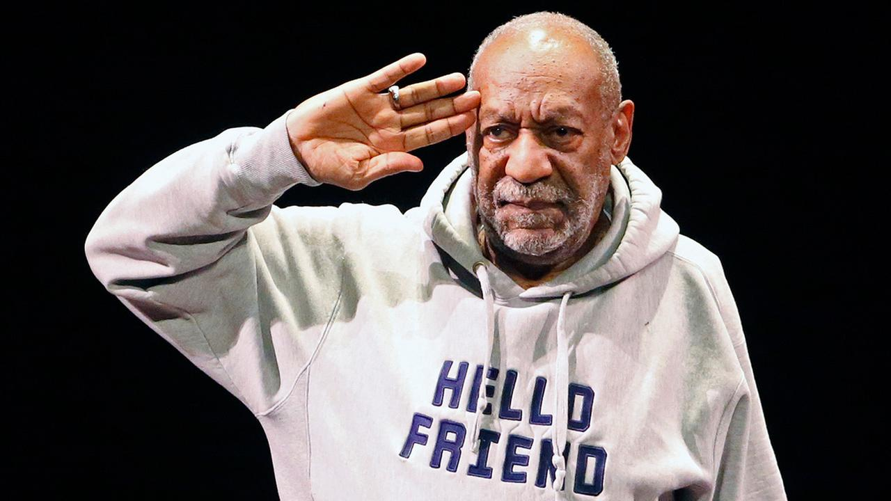 In this Jan. 17, 2015 file photo, comedian Bill Cosby salutes the crowd as he begins a performance at the Buell Theater in Denver.