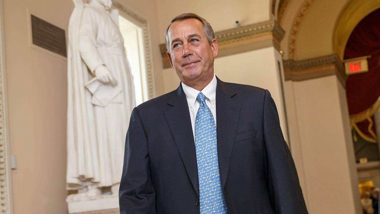 House Speaker John Boehner of Ohio walks to the House chamber on Capitol Hill in Washington, Friday, Feb. 27, 2015.