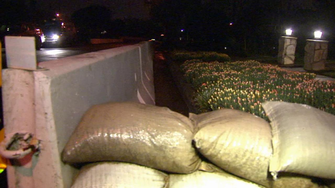 Sand bags and K-rails are put up in front of homes in Glendora on Friday, Feb. 27, 2015.