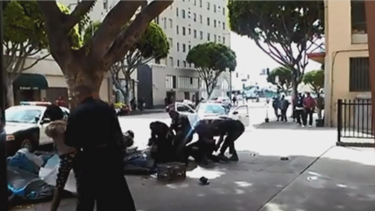 RAW VIDEO: Three Los Angeles police officers fired fatally shot a man on Skid Row during a struggle over one of the officers guns. (WARNING: VIDEO IS GRAPHIC)