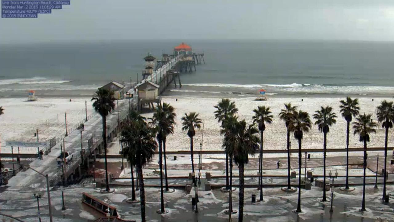 Hail blankets the sand in Huntington Beach on Monday, March 2, 2015, in this photo from HBcams.com / Innocean.