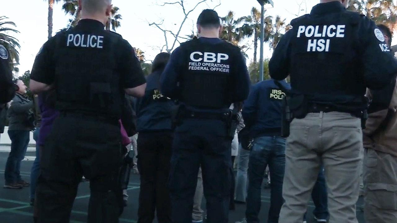 Federal agents execute search warrants at an undisclosed location in Orange County on Tuesday, March 3, 2015.
