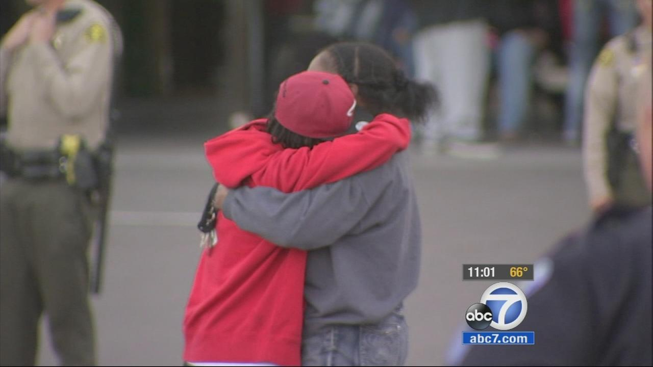 Two people embrace outside Loma Linda University Medical Center, where victims were taken following a shooting outside a nightclub in San Bernardino on Wednesday, March 4, 2015.
