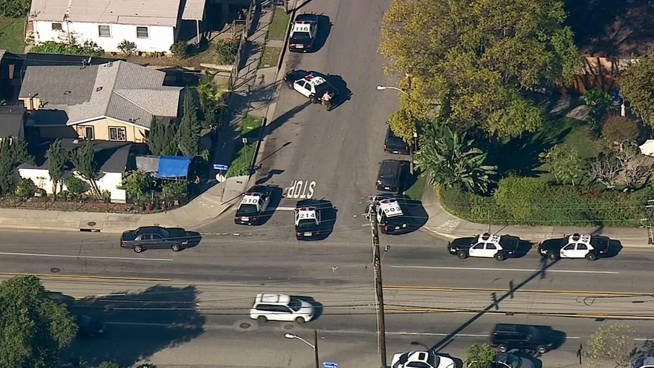 Sheriffs deputies respond to the 4200 block of Fisher Street in East Los Angeles to investigate a home-invasion robbery Wednesday, March 4, 2015.
