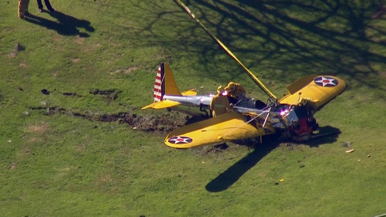 Firefighters investigate the scene of a small plane crash at a Venice Golf Course. Actor Harrison Ford was flying the small aircraft on Thursday, March 5, 2015.