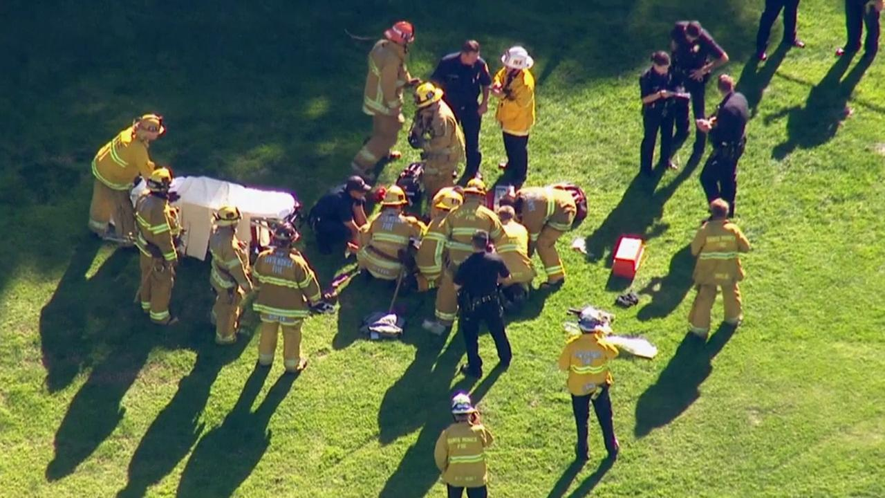 Firefighters prepare to lift Harrison Ford onto a gurney to be transported to a hospital after the actor crashed a small plane on Thursday, March 5, 2015.
