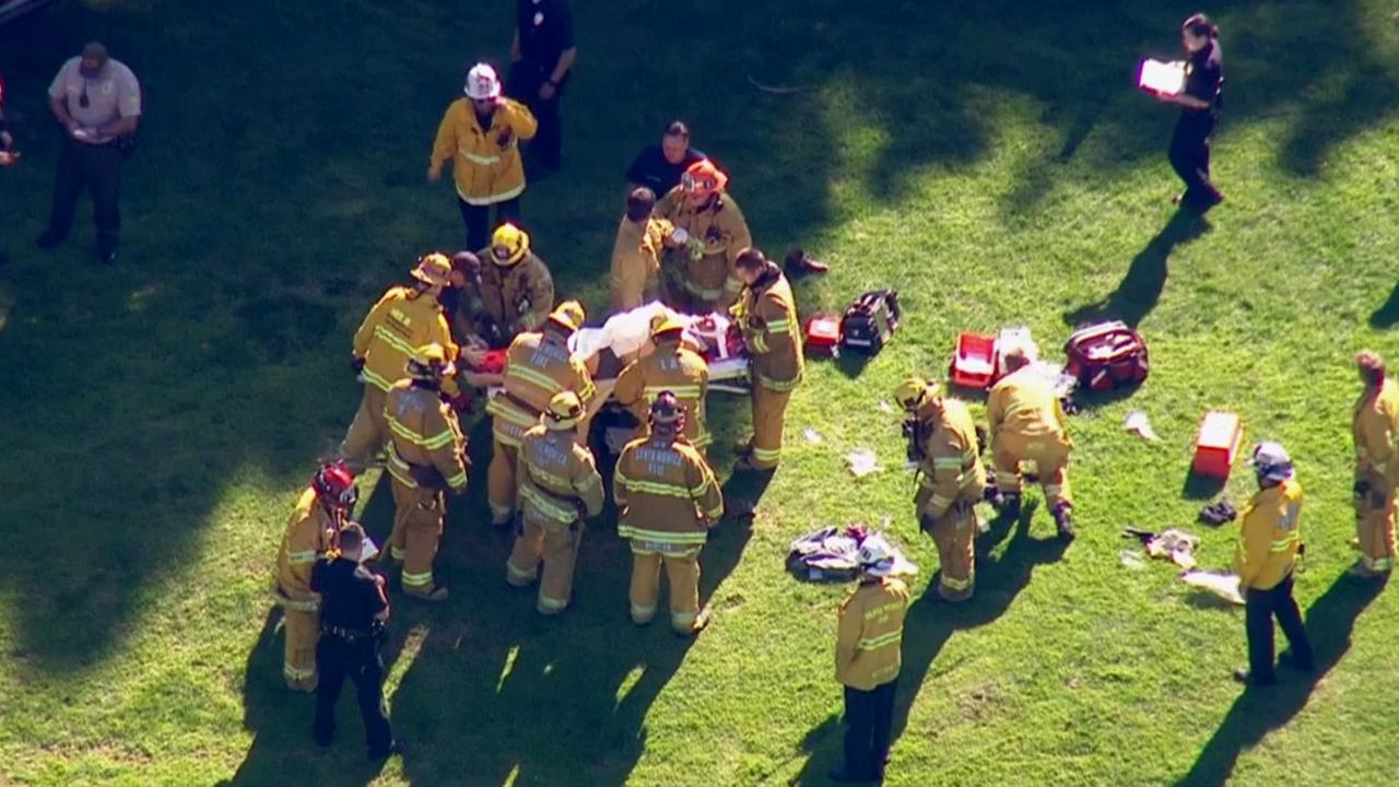 Actor Harrison Ford is place on a gurney after crashing a small plane at a Venice golf course on Thursday, March 5, 2015.