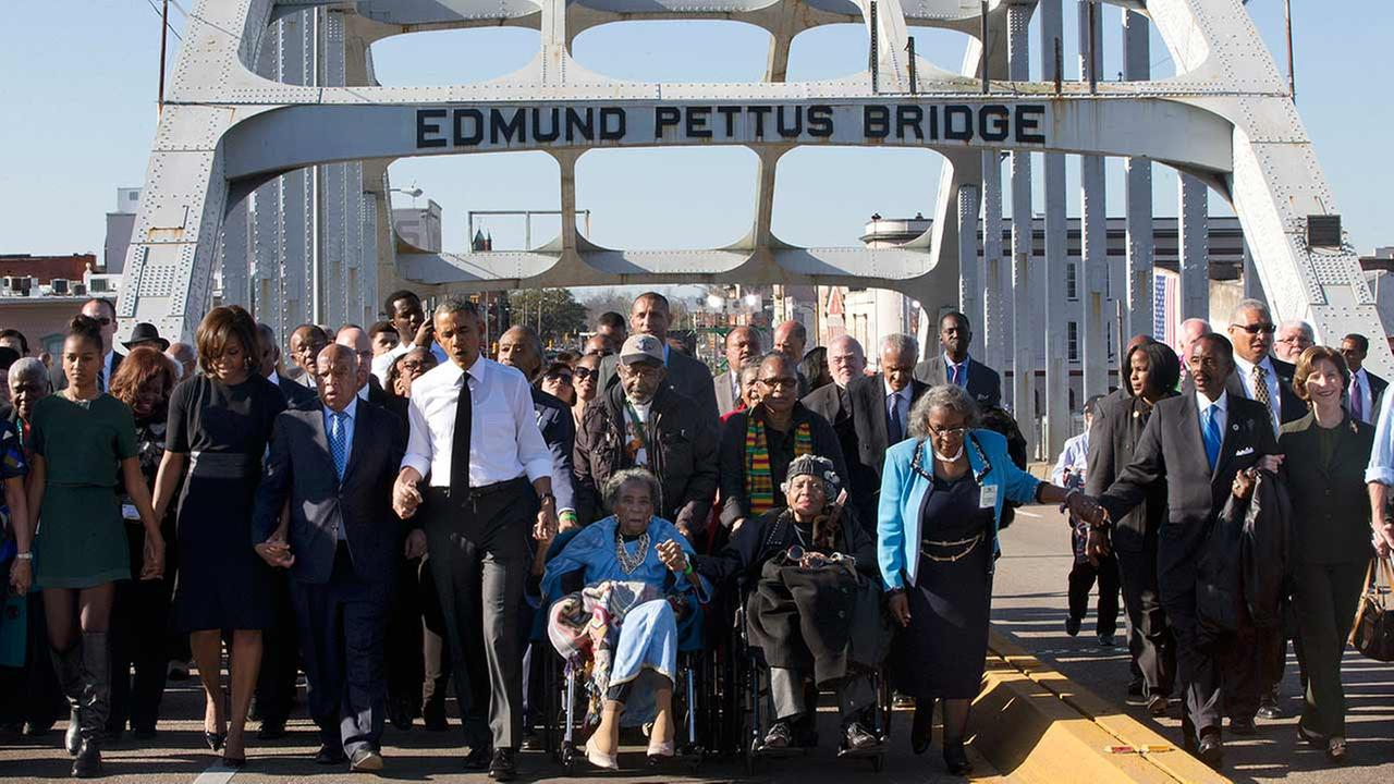 Singing We Shall Overcome, President Barack Obama, fourth from left, walks holding hands with Amelia Boynton, who was beaten during Bloody Sunday.