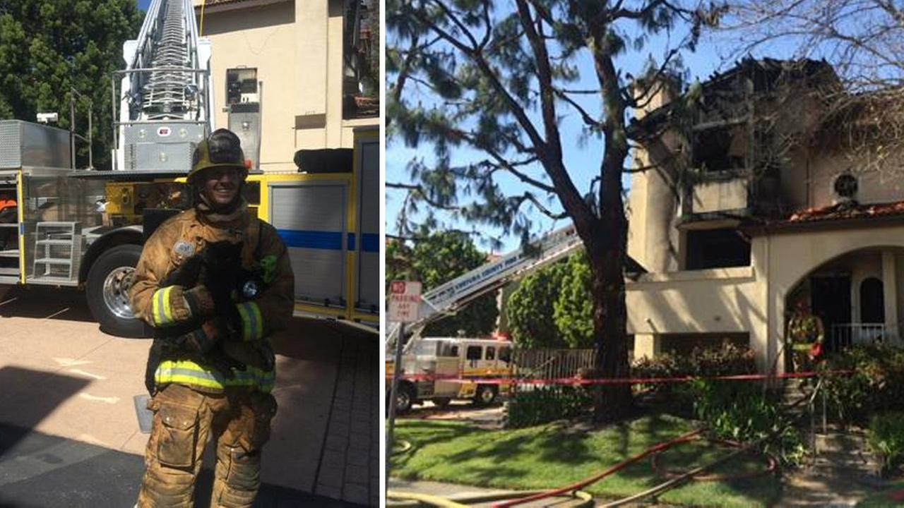 Firefighter Chris Walker rescued a cat from a condominium fire in Simi Valley Monday, March 9, 2015.