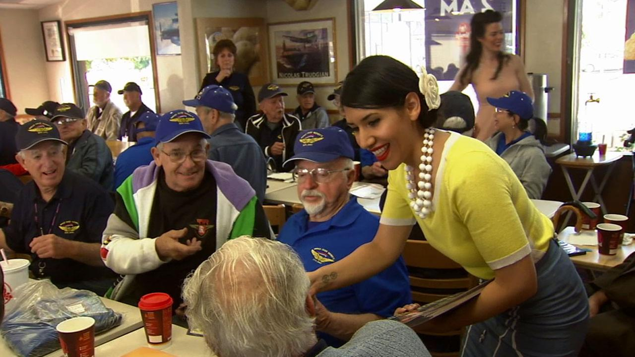 Pin-Ups for Vets brought smiles to a group of war veterans at their weekly Wings Over Wendys gathering in West Hills Monday, March 9, 2015.
