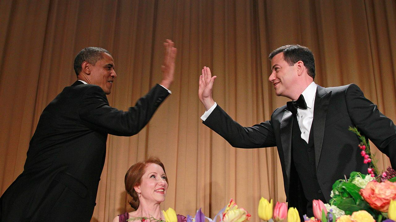 President Barack Obama high-fives late-night comic Jimmy Kimmel during the White House Correspondents Association Dinner, Saturday, April 28, 2012 in Washington.
