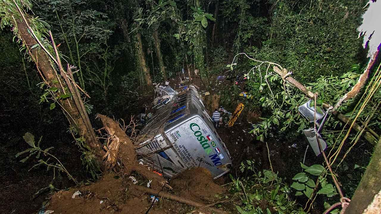 Rescue personnel work at the site where a tourist bus crashed killing at least 54 people, near the city of Joinville, southern state of Santa Catarina, Brazil, March 15, 2015.